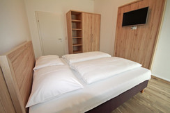 Top 3 - Bedroom 2 with double bed and TV
